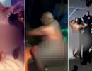 Cảnh sát say xỉn thoát y nhảy múa trong hộp đêm lọt ống kính camera
