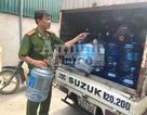 Hà Nội: Phát hiện cơ sở ngâm tẩy bình nước lọc bằng axit, soda