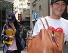 Người mẫu có chồng che mặt khi bị bắt gặp đi cùng Trần Quán Hy