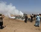Cận cảnh trực thăng Nga bị bắn rơi ở Syria, xác phi công bị kéo lê