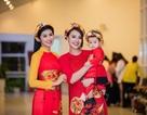 Hồng Quế bế con gái trình diễn áo dài cho Hoa hậu Ngọc Hân