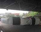 Xe container lật dưới gầm cầu Đồng Nai, 2 người suýt bị đè bẹp