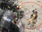 Khởi tố nữ công nhân ném đá cảnh sát cơ động