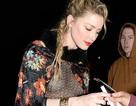 Amber Heard diện áo không nội y