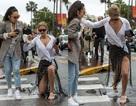 Tình cũ của Leonardo DiCaprio trượt chân ngã trong trời mưa