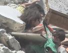 """Ảnh bé gái Syria 5 tuổi cứu em từ ngôi nhà trúng tên lửa gây """"ám ảnh"""""""