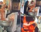 """Nga: Video hãi hùng linh mục rửa tội như """"dìm chết"""" em bé"""