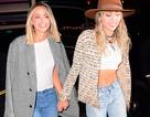 Miley Cyrus hạnh phúc nắm tay bạn gái dự tiệc