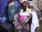 Bé trai sống sót sau khi bị kẹt trong đống đổ nát của vụ nổ chung cư Nga
