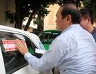 Hà Nội dán đề can tuyên truyền luật giao thông cho gần 20.000 xe taxi