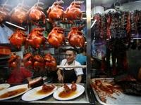Lý giải sức hút món ăn hè phố của Singapore