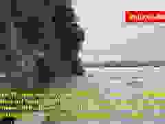 Cảnh nước lũ dâng tới chân tượng Phật khổng lồ