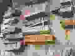 Quan tài chứa xác người chết treo lủng lẳng trên vách đá hàng nghìn năm