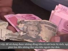 Thợ sửa tiền - cứu tinh cho những đồng USD rách tại Zimbabwe