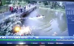 Bố lôi con khỏi ô tô đang chìm ném lại lên cầu để giải cứu