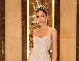 Hoàng Thùy khoe dáng đồng hồ cát trước ngày thi Hoa hậu Hoàn vũ