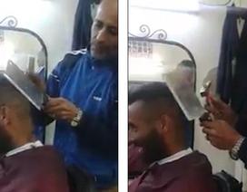 Rợn người xem thợ dùng búa và dao chặt xương để... cắt tóc