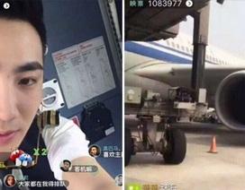 """Trung Quốc: Phát hoảng phi công """"lên sóng trực tiếp"""" bằng điện thoại khi đang bay"""