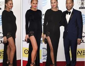 Siêu mẫu Mỹ diện váy xẻ bạo, bế bụng bầu sánh đôi bên chồng