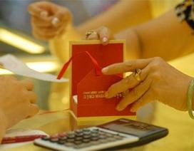 Tỷ giá tăng, vàng SJC sụt giảm