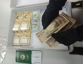 Nữ hành khách bị tạm giữ khi mang hơn nửa tỷ đồng xuất cảnh