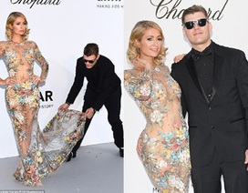 Paris Hilton liên tục được bạn trai chỉnh váy
