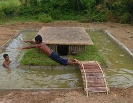 """Clip hai người đàn ông xây bể bơi bằng tay không """"phát sốt"""" trên Internet"""