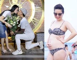 Lê Khánh khoe bụng bầu 5 tháng; Tuấn Hưng quỳ gối tặng hoa cho bà xã