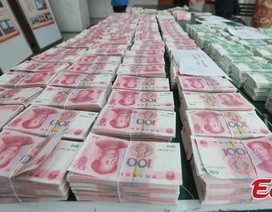 Trung Quốc: Bị bắt vì in tiền giả để thanh toán viện phí