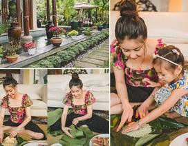 Hoa hậu Hà Kiều Anh mặc giản dị cùng các con gói bánh chưng ngày Tết
