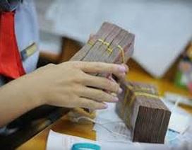 Mỗi tháng xử lý 9,6 nghìn tỷ đồng nợ xấu; cổ phần hóa Agribank