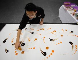 Du học sinh Việt dùng thức ăn vẽ tranh nghệ thuật lên báo Tây Ban Nha