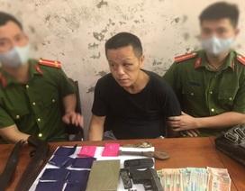 Đối tượng người Lào vận chuyển ma túy kèm súng quân dụng