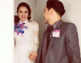 Trang Nhung diện áo dài kết hoa e ấp bên chú rể đại gia
