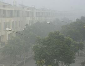Nhà cao tầng mờ ảo trong sương mù ở Tây Nam Hà Nội