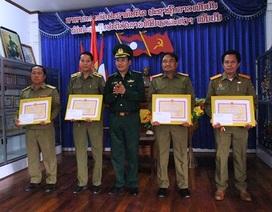 Trao Bằng khen cho lực lượng đánh án nước bạn Lào