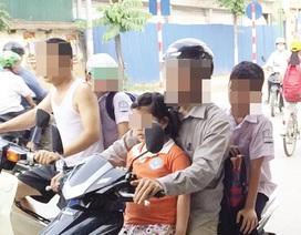 Hà Nội: Cha mẹ học sinh phải kí cam kết đội mũ bảo hiểm cho con