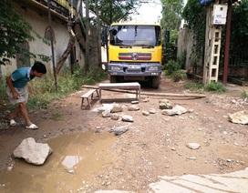 Vụ dân mang bàn ghế chắn xe chở đất gây bụi: Doanh nghiệp xây đường mới cho dân