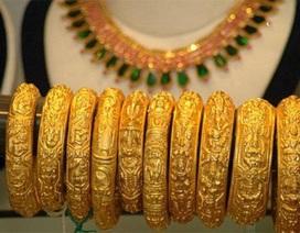 Giá vàng thế giới tăng mạnh, chạm ngưỡng 1.300 USD/oz