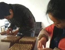 Trung Quốc: Mang 60 kg tiền xu đi mua xe tải