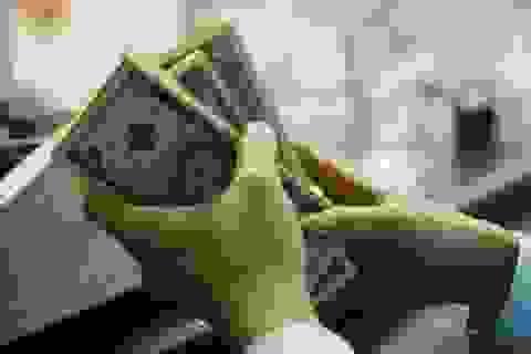 Chênh lệch tỷ giá chợ đen và ngân hàng đã từng lên 1.800 VND/1 USD