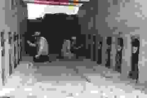Phát lộ hàng loạt tượng gỗ bí ẩn tại thành cổ bằng đất sét lớn nhất thế giới