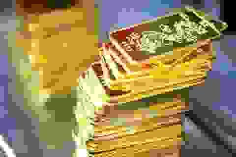 Giá USD rời đỉnh, vàng bật tăng