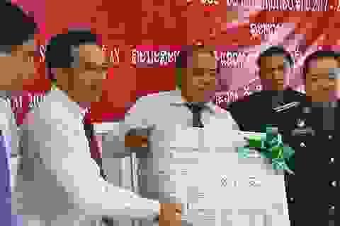 Tiếp nhận 98 hài cốt liệt sĩ quân tình nguyện và chuyên gia Việt Nam hy sinh tại Lào