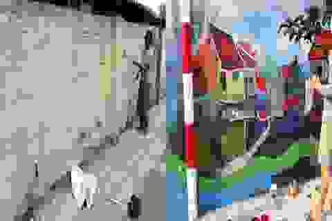 """Vẽ tranh cổ động để """"cứu"""" những bức tường đầy quảng cáo, rêu mốc"""