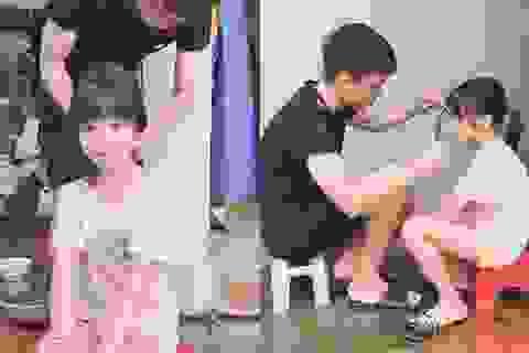 Dân mạng thích thú với hình ảnh anh trai cắt tóc, chải đầu cho em gái