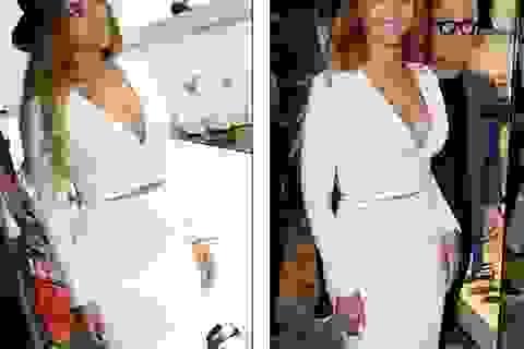 Beyonce trẻ trung với váy trắng ôm sát