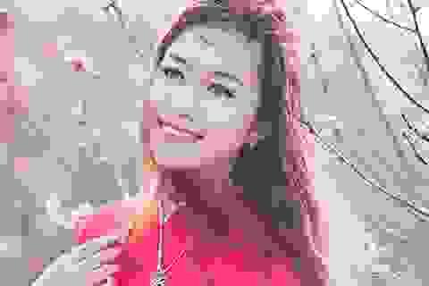 Ngắm vẻ đẹp rạng rỡ của thiếu nữ Hà Nội cùng đào xuân
